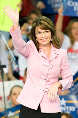 Doesn't Sarah Palin look pretty in girly pink? Or does she look competent?